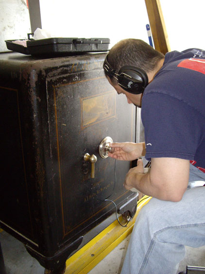 Anthony opening a safe